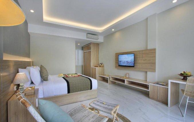 Slaapkamer van hotel Tapa Tepi Kali in Bali