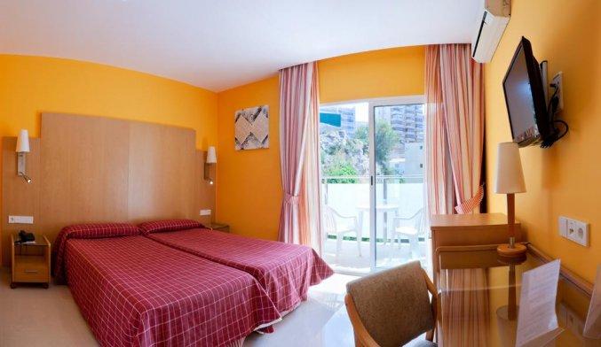 Slaapkamer van hotel La Cala in Alicante