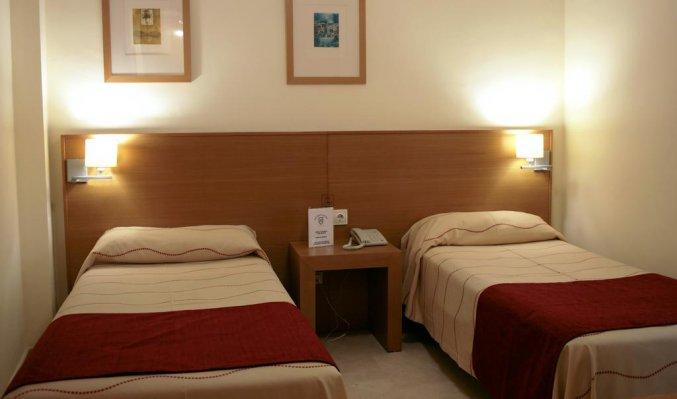 Slaapkamer van hotel Milord's Suites in Alicante