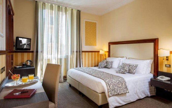Slaapkamer van hotel Savoy in Rome
