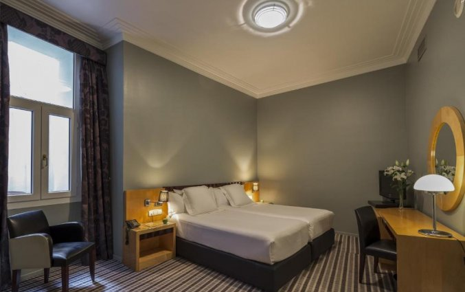 Slaapkamer van hotel Room Mate Larios in Malaga