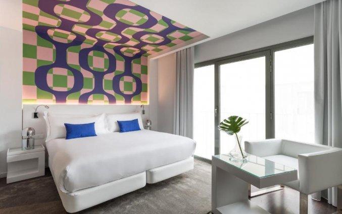 Slaapkamer van hotel Room Mate Carlain Barcelona