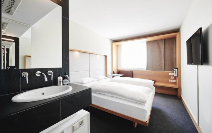 Slaapkamer van hotel Daniel Graz in Graz