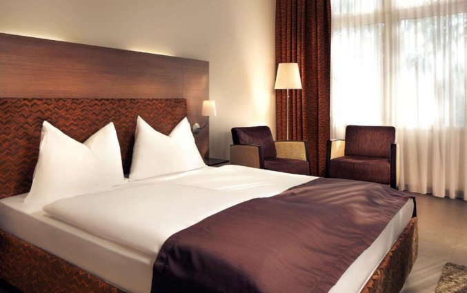 Slaapkamer van hotel Mercure Graz City inGraz