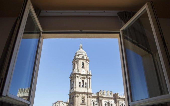 Uitzicht op de kathedraal vanaf een kamer in hotel Petit Palace Plaza Malaga