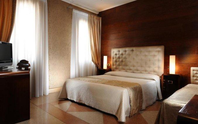 Slaapkamer van Hotel Abbazia