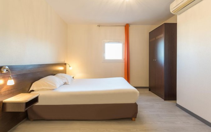 Tweepersoonskamer van aparthotel City Résidence Bordeaux Centre in Bordeaux