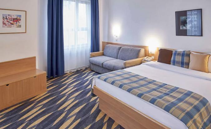 Slaapkamer in hotel Novotel Centre Moskou