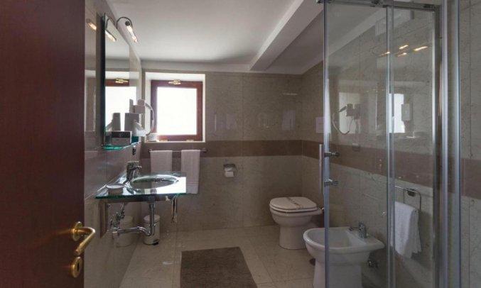Badkamer van Hotel San Luca