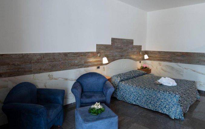 Kamer met zithoek van Hotel San Luca