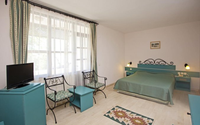 Slaapkamer van Hotel Club Titan in Alanya