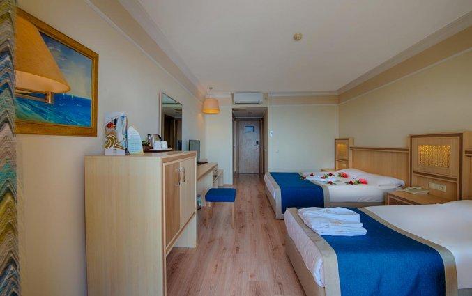 Slaapkamer van Hotel Utopia World in Alanya