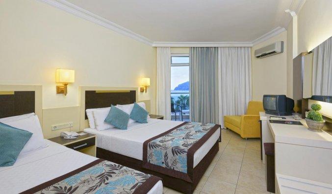 Slaapkamer van Hotel Monart City in Alanya