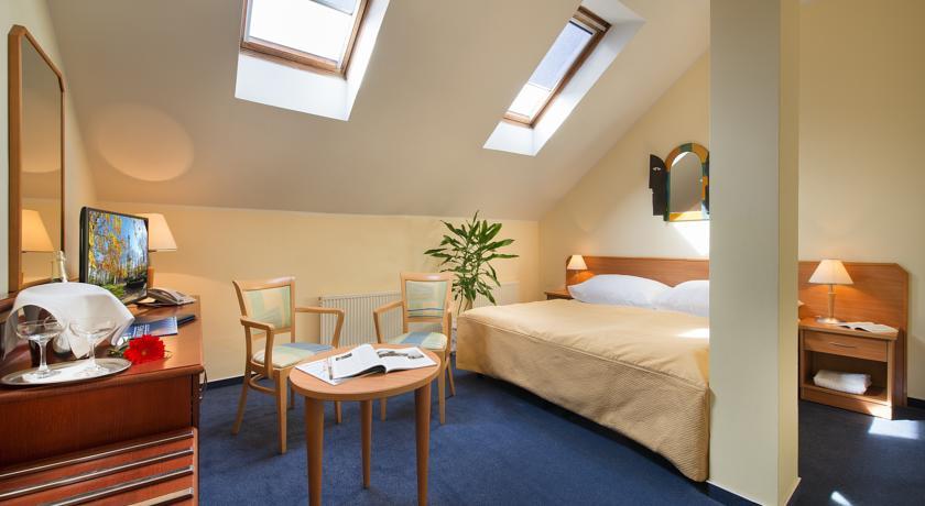 Slaapkamer van hotel Tosca in Praag