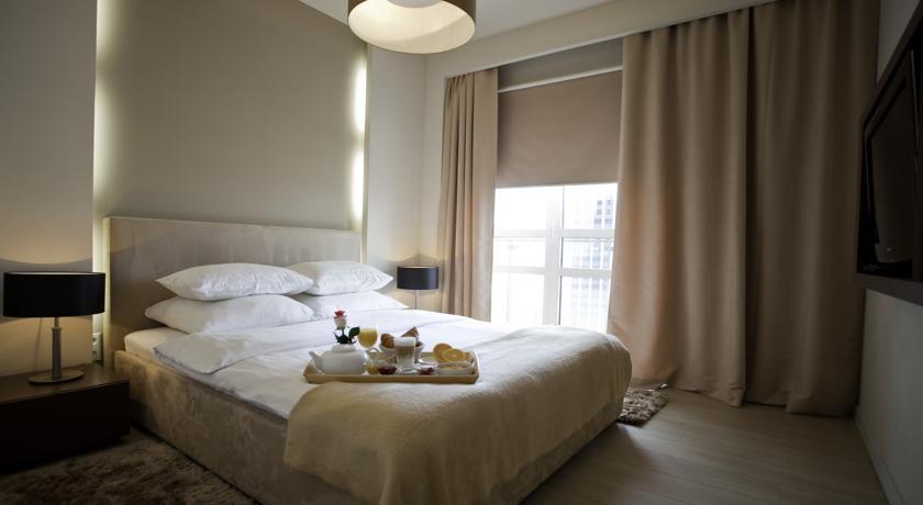 Slaapkamer van Aparthotel Platinum Residence in Warschau