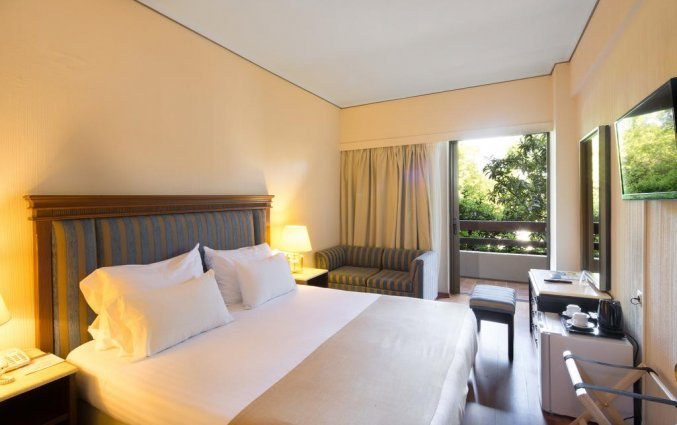 Slaapkamer van hotel Corfu Holiday Palace in Corfu