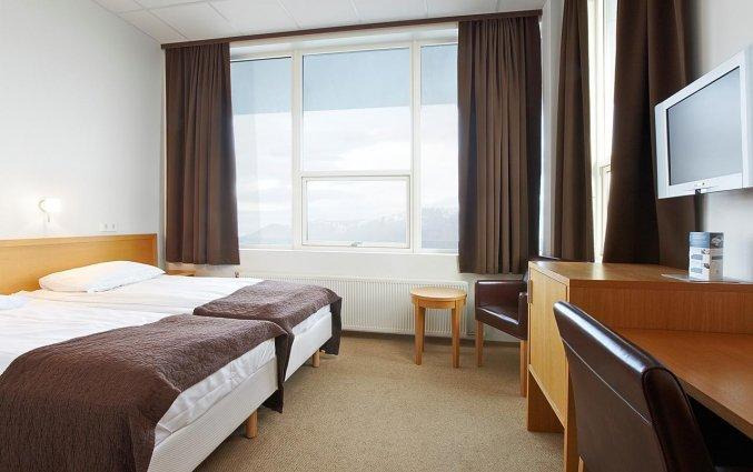 Tweepersoonskamer van hotel cabin in IJsland