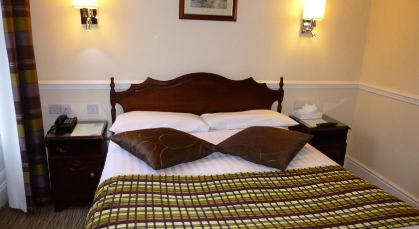 Slaapkamer van hotel Harcourt in Dublin