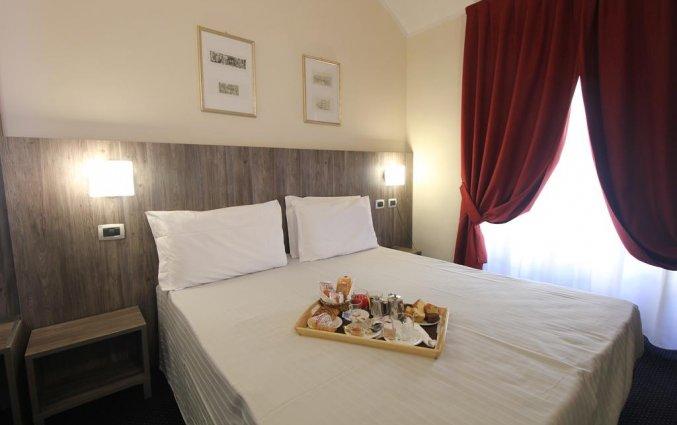 Slaapkamer in Hotel Urbani Turijn