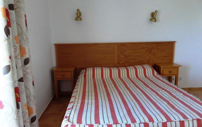 Tweepersoonsbed in een kamer van Appartementen Mirachoro 2