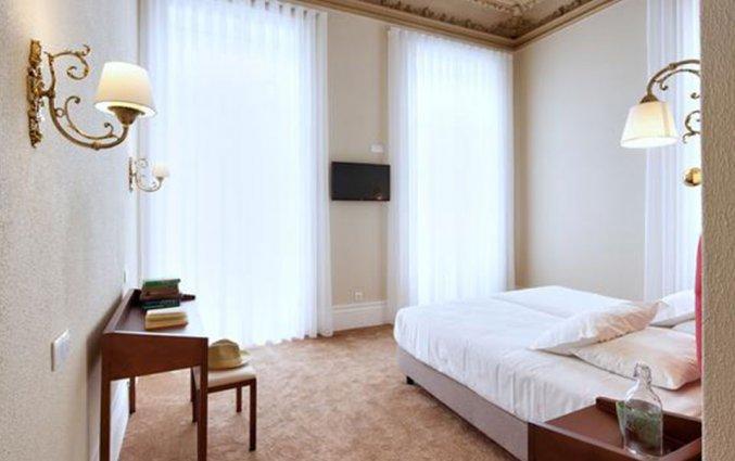 Slaapkamer van Hotel The Rex in Porto