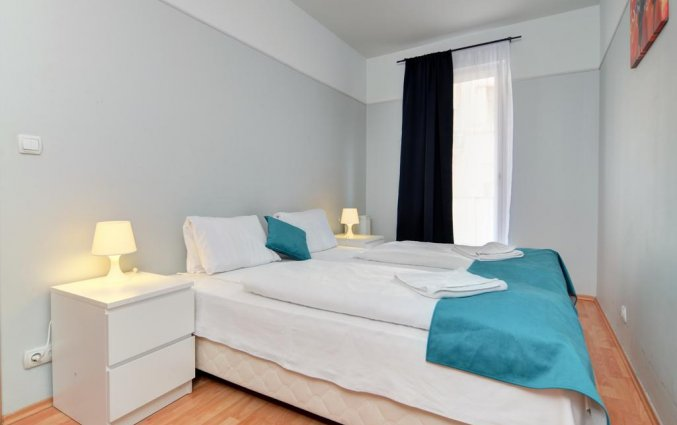 Slaapkamer in appartement van Aparthotel Agape in Budapest