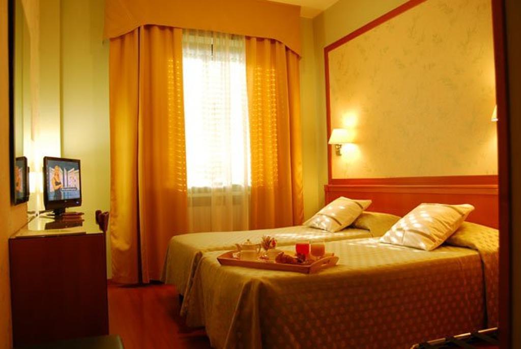 Slaapkamer van Eco-Hotel La Residenza in Milaan