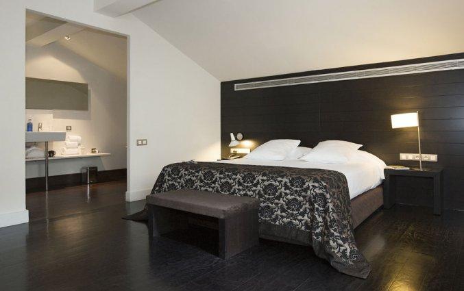 Slaapkamer van hotel Hospes Palau de La Mar in Valencia