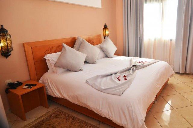 Een tweepersoonsbed van Aparthotel Atlantic Palm Beach Agadir