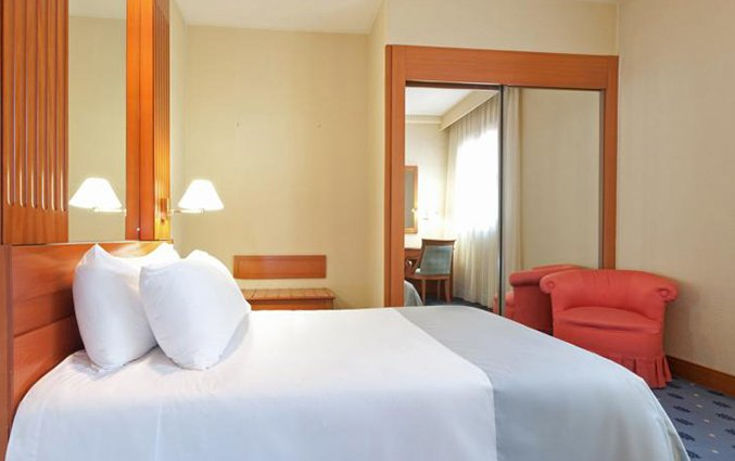 Slaapkamer van hotel Sevilla Macarena in Sevilla
