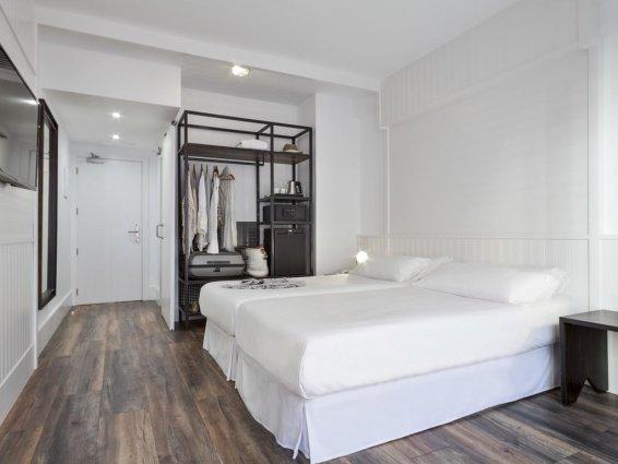 Slaapkamer van Hotel Delamar in Lloret de Mar