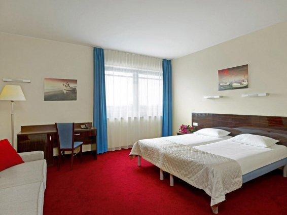 Tweepersoonsbed in kamer van Hotel Focus in Gdansk