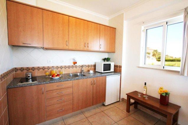 Een keuken van een appartement van Hotel Clube Mos Algarve