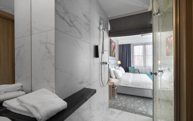 Badkamer van een tweepersoonskamer van Hotel Golden Tulip Krakow Kazimierz in Krakau