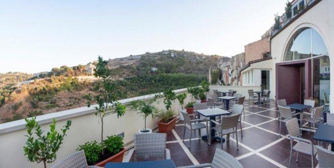 Terras van Hotel San Giorgio Palace op Sicilië