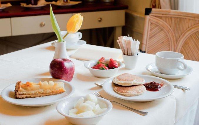 Tafel met ontbijt van Hotel iH Milano Regency Milaan Italië
