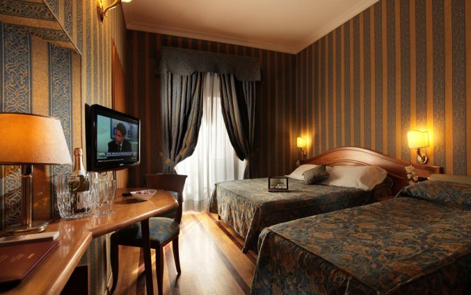 Slaapkamer van hotel Solis in Rome