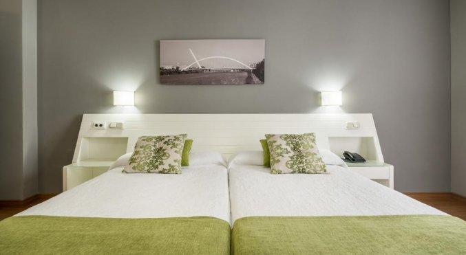 Slaapkamer van Hotel Alcora in Sevilla
