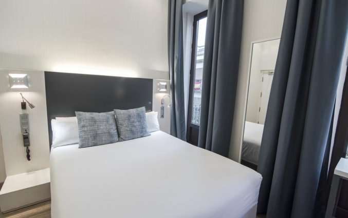 Slaapkamer in Hotel Petit Palace Canalejas in Seville