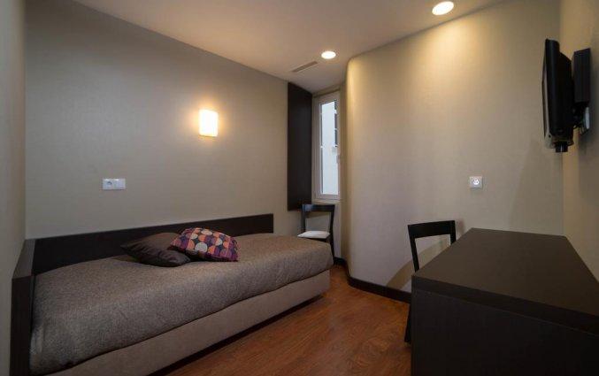 Zitgedeelte kamer hotel Expo Astoria in Lissabon