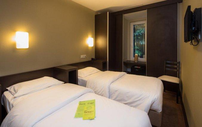 Slaapkamer twin bed hotel Expo Astoria in Lissabon