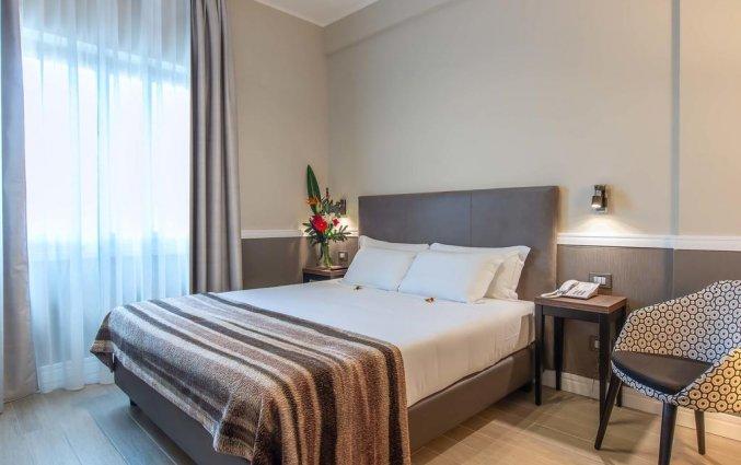 Slaapkamer van Fragrance Hotel St. Peter in Rome