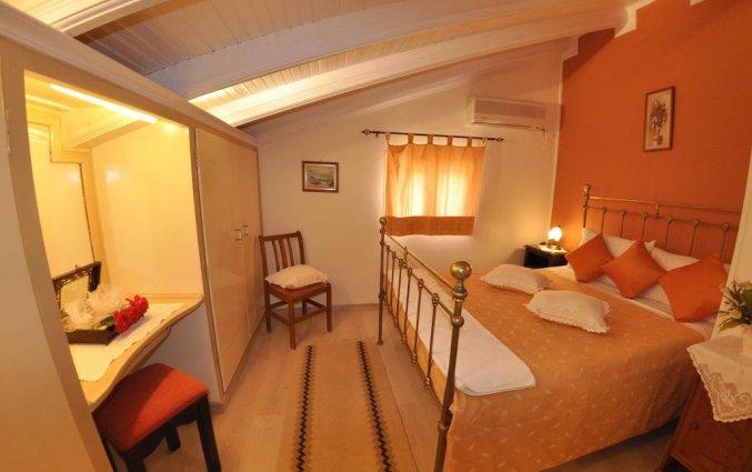 Slaapkamer van een appartement van Appartementen Mazis op Corfu