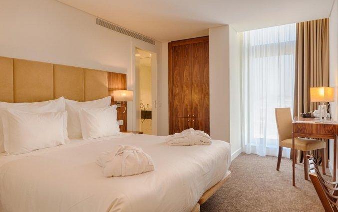 Tweepersoonskamer met tweepersoonsbed van hotel Premium Porto Downtown in Porto