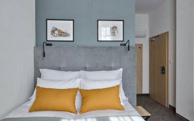 Slaapkamer van hotel 32 Krakow Old Townin Krakau