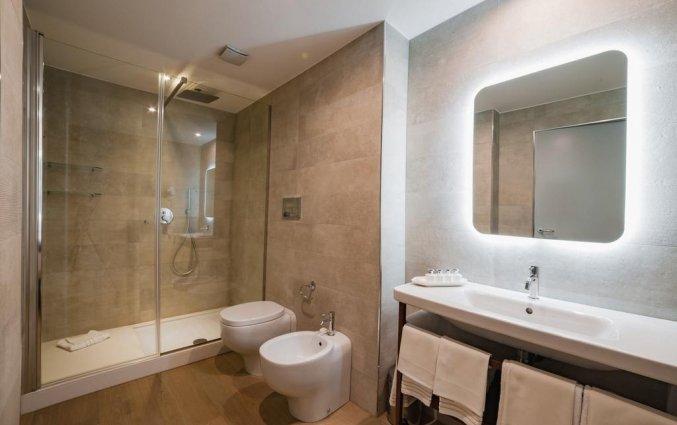 Badkamer van een tweepersoonskamer van Resort Spa Cala Ponte in Puglia