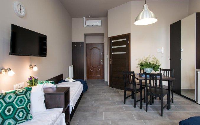 Woonkamer van een appartement van appartementen Happy Tower Krakow in Krakau