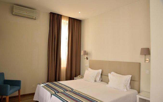 Kamer met enkele bedden van Hotel Domus in Porto