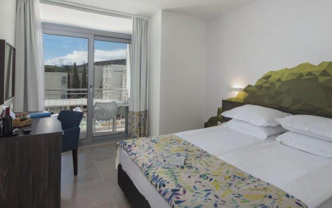 Slaapkamer van Hotel Bluesun Alga in Dalmatië