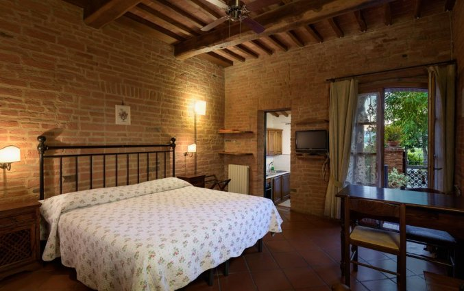 Tweepersoonskamer van appartement La Casa Delle Querce